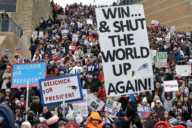 Patriots fans wish their team well during a Super Bowl send-off rally Monday. (AP)