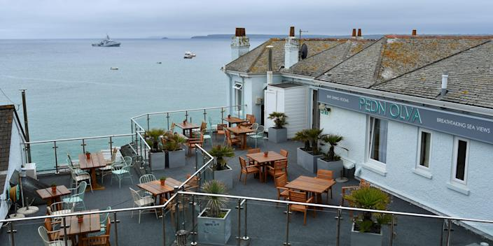 A view of the Pedn Olva hotel and deck overlooking the English seaside.