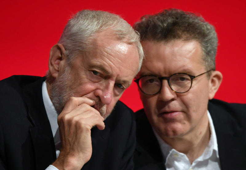 Britain's opposition Labour Party leader Jeremy Corbyn, left, talks with deputy leader Tom Watson during the start of the party's annual conference in Liverpool, England, Sunday Sept. 23, 2018. Britain's Labour Party is facing a huge choice at its annual conference, whether to back a new Brexit referendum on the country's departure from the European Union. (Stefan Rousseau/PA via AP)