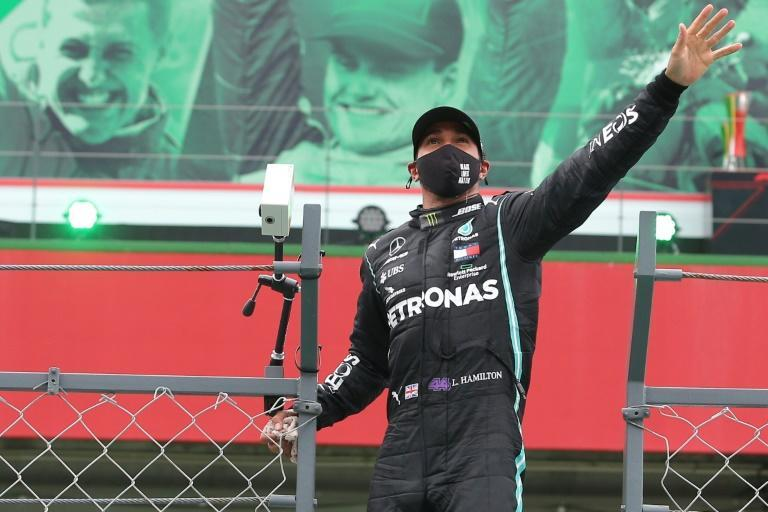 Record breaker: Lewis Hamilton waves to the spectators after winning the Portuguese Grand Prix