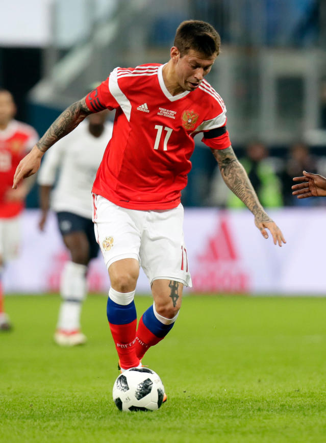 FILE - In this Tuesday, March 27, 2018. file photo, Russia's Fyodor Smolov takes the ball forward during the international friendly soccer match between Russia and France at the Saint Petersburg stadium in St.Petersburg, Russia. (AP Photo/Dmitri Lovetsky, File)