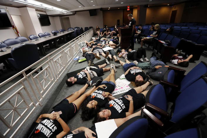 <p>Seventeen student survivors from Marjory Stoneman Douglas High School lie down on the floor in silence and pray at the approximate time of the attack one week ago, inside the state capitol, in Tallahassee, Fla., Wednesday, Feb. 21, 2018. (Photo: Gerald Herbert/AP) </p>