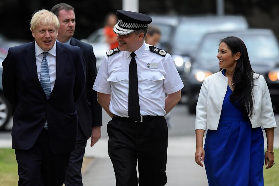 Prime Minister Boris Johnson and Home Secretary Priti Patel meet with Chief Constable of West Midlands Police Dave Thompson as they arrive at West Midlands Police Learning and Development Centre, Birmingham, where he will announce his plan to recruit an extra 20,000 police officers and an urgent review will take place of plans to make it easier for forces to use stop-and-search powers.