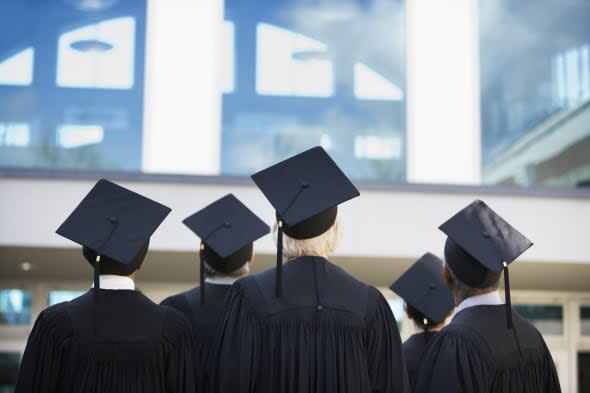 Graduates Wearing Caps and Gowns