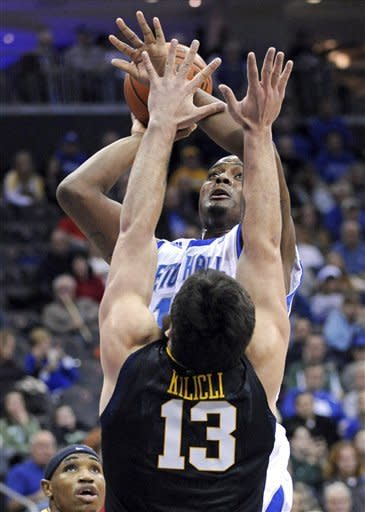 Seton Hall's Herb Pope, top, looks to shoot over West Virginia's Deniz Kilicli (13), of Turkey, during the first half of an NCAA college basketball game on Friday, Dec. 30, 2011, in Newark, N.J. (AP Photo/Bill Kostroun)