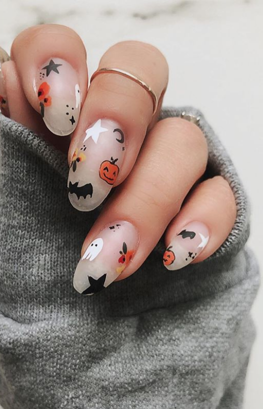 """<p><a href=""""https://www.instagram.com/p/B4K2-IVjCdQ/"""" rel=""""nofollow noopener"""" target=""""_blank"""" data-ylk=""""slk:Nail artist Nina Park"""" class=""""link rapid-noclick-resp"""">Nail artist Nina Park</a> adds in little floral accents to her pumpkin, bats, and ghost-adorned mani for a cute take on the Halloween theme.</p><p><a class=""""link rapid-noclick-resp"""" href=""""https://go.redirectingat.com?id=74968X1596630&url=https%3A%2F%2Fwww.etsy.com%2Flisting%2F164775952%2Fhalloween-nail-decals&sref=https%3A%2F%2Fwww.oprahmag.com%2Fbeauty%2Fskin-makeup%2Fg33239588%2Fhalloween-nail-ideas%2F"""" rel=""""nofollow noopener"""" target=""""_blank"""" data-ylk=""""slk:SHOP NAIL DECALS"""">SHOP NAIL DECALS</a></p>"""