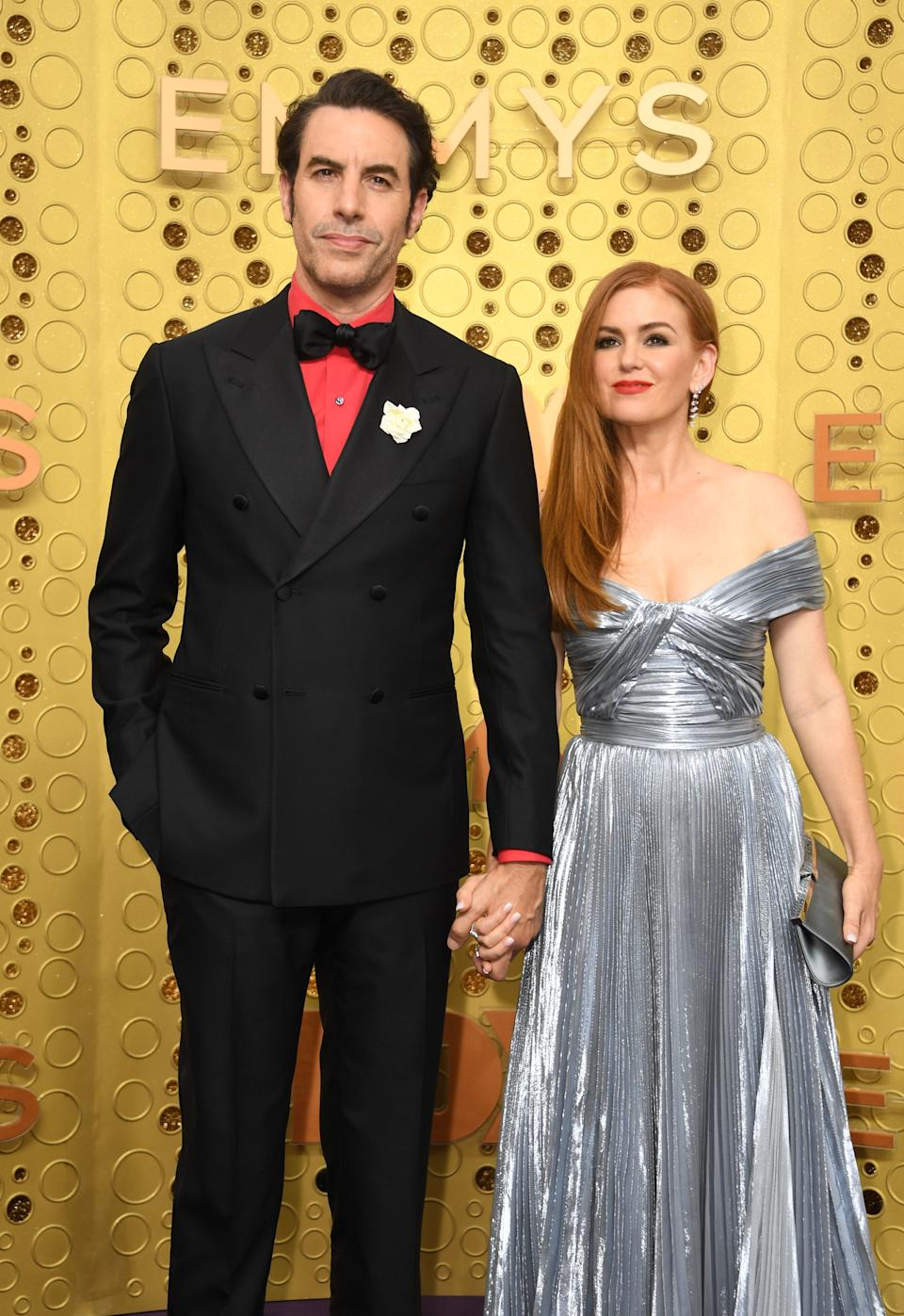 """<h1 class=""""title"""">Sacha Baron Cohen in Isaia with Montblanc jewelry and Isla Fisher in Zuhair Murad</h1><cite class=""""credit"""">Photo: Getty Images</cite>"""