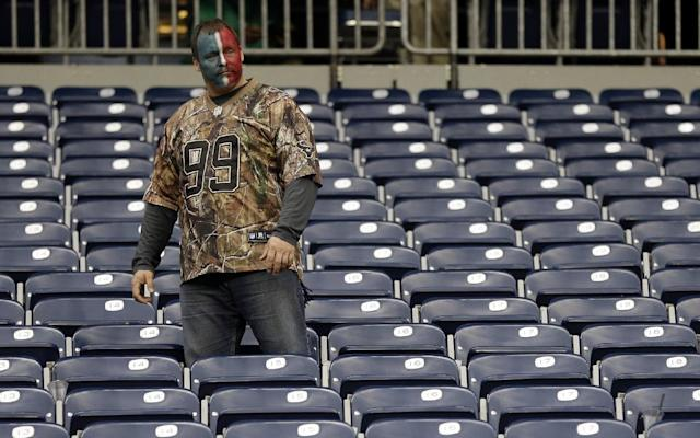 A Houston Texans fan looks down on the field after an NFL football game against the Jacksonville Jaguars Sunday, Nov. 24, 2013, in Houston. The Jaguars won 13-6. (AP Photo/David J. Phillip)