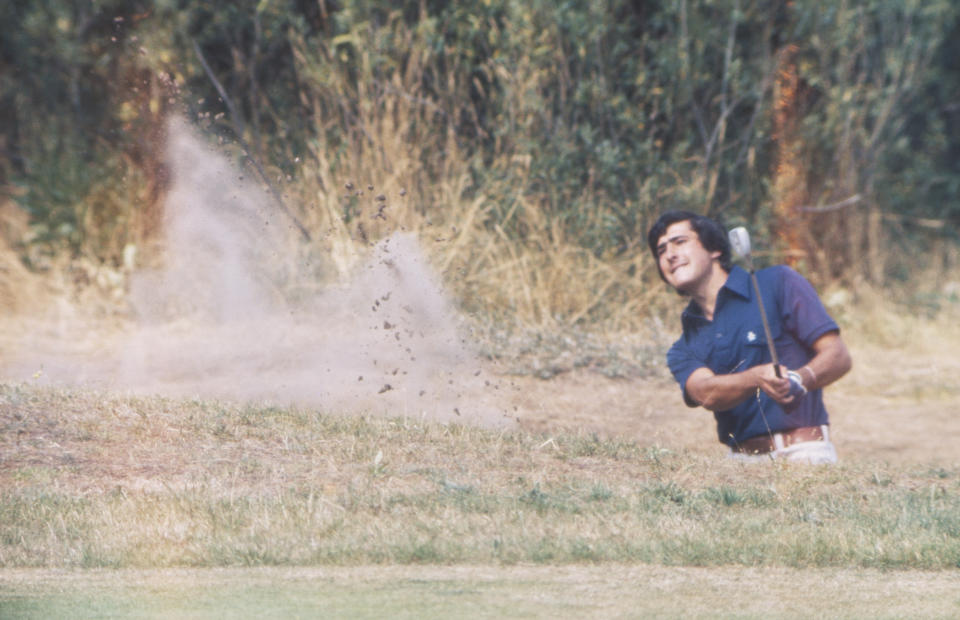 SOUTHPORT, ENGLAND - JULY 1976:   Seve Ballesteros of Spain hits a bunker shot during The 105th Open Championship held at Royal Birkdale Golf Club from July 7-10,1976 in Southport, England. (Photo by R&A via Getty Images)
