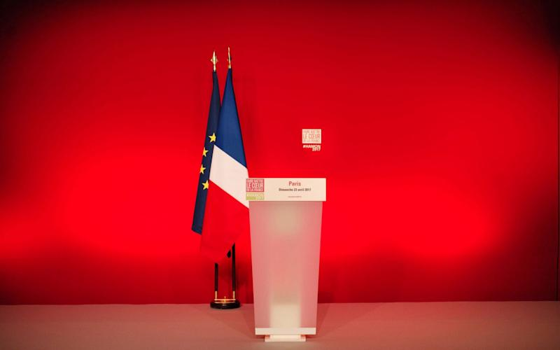 The empty podium of French presidential election candidate for the left-wing French Socialist party Benoit Hamon  - Credit: MARTIN BUREAU/AFP