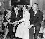 "<p>Prince Rainier and Kelly staged a photo-op in her family home in Philadelphia, alongside her parents, in January 1956. The actress shows off her engagement ring, a 10.48-carat <a href=""https://www.townandcountrymag.com/style/jewelry-and-watches/a27698288/charlotte-casiraghi-princess-grace-wedding-jewelry/"" rel=""nofollow noopener"" target=""_blank"" data-ylk=""slk:emerald-cut diamond"" class=""link rapid-noclick-resp"">emerald-cut diamond</a> from Cartier. </p>"