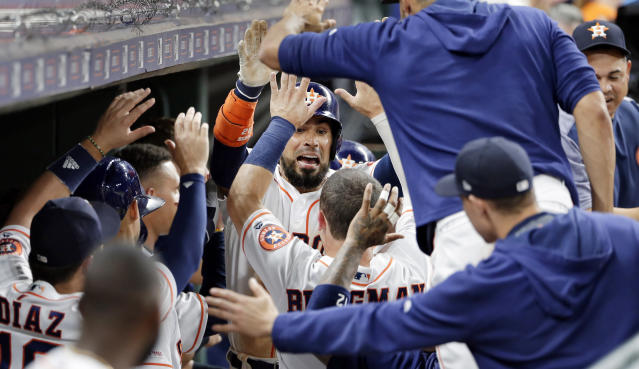 Houston Astros' Robinson Chirinos, celebrates in the dugout after his two run home run during the fourth inning of a baseball game against the Tampa Bay Rays Tuesday, Aug. 27, 2019, in Houston. (AP Photo/Michael Wyke)