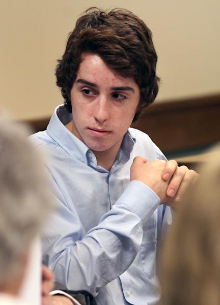 T.J. Lane, 17, appears in Juvenile Court in Chardon, Ohio, on Thursday, May 24, 2012. Lane is charged in the Feb. 27 Chardon High School rampage that left three students dead and two students seriously wounded. Geauga County Prosecutor David Joyce was to argue in court Thursday that Lane should face trial as an adult. (AP Photo/Aaron Josefczyk, Pool)