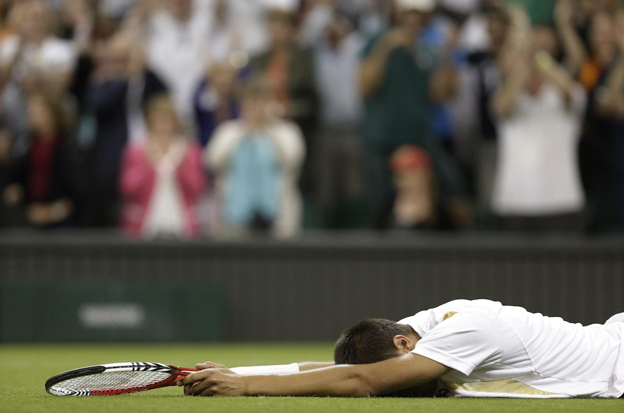 Lukas Rosol of the Czech Republic reacts after defeating Rafael Nadal of Spain during a second round men's singles match at the All England Lawn Tennis Championships at Wimbledon, England, Thursday, June 28, 2012. (AP Photo/Anja Niedringhaus)