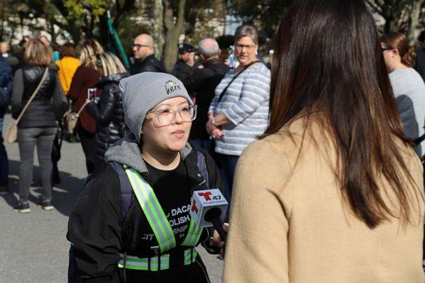 PHOTO: Carolina Fung Feng of New York City, a DACA recipient, speaks with a reporter before embarking on a march to the Supreme Court in Washington, D.C., on Oct. 26, 2019. (Juan Gastelum/National Immigration Law Center)