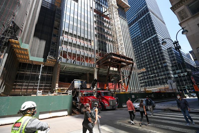 NEW YORK, USA - JUNE 8: Construction trucks are seen at a construction as sitting outside in restaurants and cafes and production and construction sectors are allowed to start working after New York City began first phase of reopening after nearly three months of shutdown in New York, United States on June 8, 2020. (Photo by Tayfun Coskun/Anadolu Agency via Getty Images)