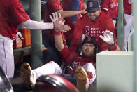 Boston Red Sox's Christian Arroyo is pushed in a dugout cart to celebrate after hitting a three-run home run against the Houston Astros during the fifth inning of a baseball game at Fenway Park, Thursday, June 10, 2021, in Boston. (AP Photo/Elise Amendola)
