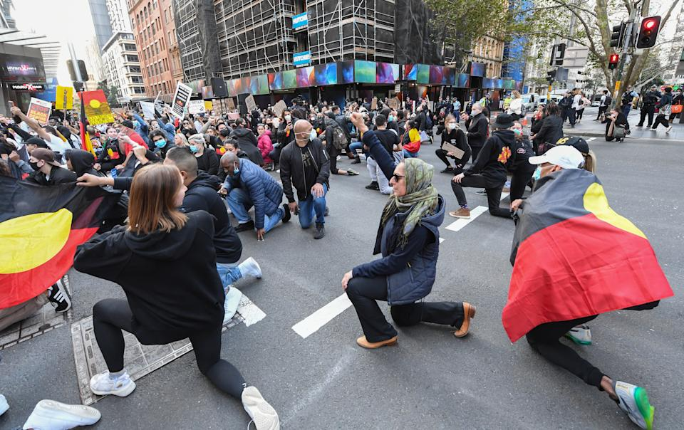 """SYDNEY, AUSTRALIA - JUNE 06: Thousands of protestors marching in solidarity with """"Black Lives Matter"""" down Castlereagh Street in the CBD on June 06, 2020 in Sydney, Australia. The event was organised to rally against aboriginal deaths in custody in Australia as well as in solidarity with protests across the United States following the killing of an unarmed black man George Floyd at the hands of a police officer in Minneapolis, Minnesota. (Photo by James D. Morgan/Getty Images)"""