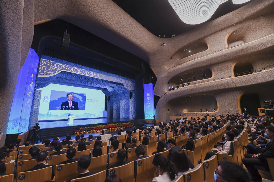 """In this photo released by Xinhua News Agency, Vice Minister of Education Tian Xuejun, who is also Director of the Chinese National Commission for UNESCO delivers his opening speech on a screen during the opening ceremony of the 44th session of the World Heritage Committee of UNESCO in Fuzhou in southeast China's Fujian Province on Friday, July 16, 2021. The Chinese host of this year's meeting of the U.N, World Heritage Committee defended on Sunday, July 18, the body's proposal to label the Great Barrier Reef as """"in danger"""" against Australian government suspicion that China influenced the finding for political reasons. Tian Xuejun said Australia should attach importance to the opinions of advisory bodies instead of making groundless accusations. (Song Weiwei/Xinhua via AP)"""