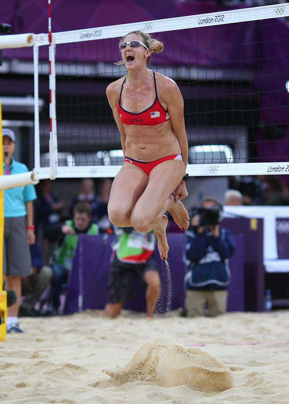 LONDON, ENGLAND - AUGUST 07: Kerri Walsh Jennings of the United States celebrates after winning match point during the Women's Beach Volleyball Semi Final match between United States and China on Day 11 of the London 2012 Olympic Games at Horse Guards Parade August 7, 2012 in London, England. (Photo by Ryan Pierse/Getty Images)