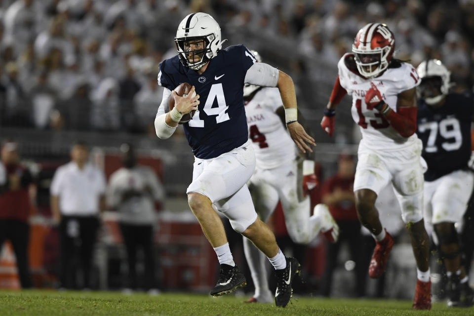 Penn State quarterback Sean Clifford (14) scrambles against Indiana in the second half of their NCAA college football game in State College, Pa., on Saturday, Oct. 02, 2021. Penn State defeated Indiana 24-0. (AP Photo/Barry Reeger)