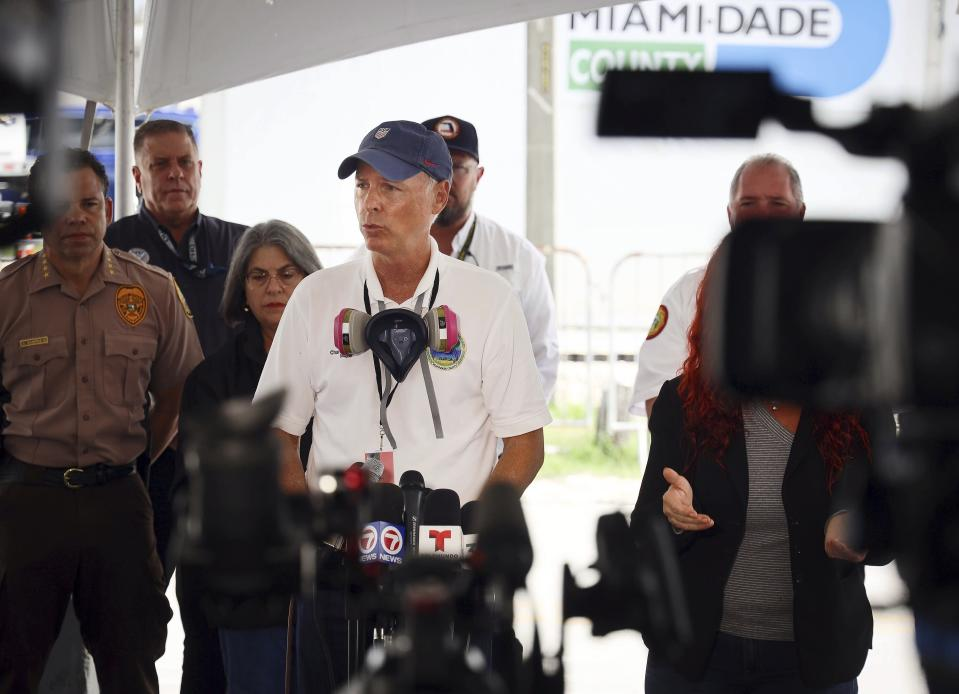 Surfside Mayor Charles Burkett gives remarks during the daily morning news conference outside the County's operational center on Sunday, July 11, 2021 in Surfside, Fla. Miami-Dade and Surfside mayors updated the media on the overnight and daily operational details after the partial collapse of the Champlain Towers South. (Carl Juste/Miami Herald via AP)