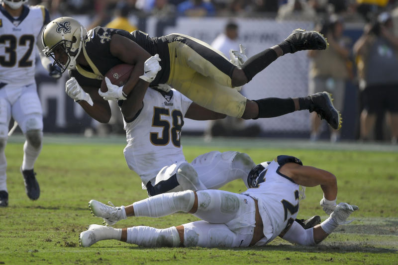 New Orleans Saints wide receiver Michael Thomas, top, is tackled by Los Angeles Rams inside linebacker Cory Littleton during the second half of an NFL football game Sunday, Sept. 15, 2019, in Los Angeles. (AP Photo/Mark J. Terrill)
