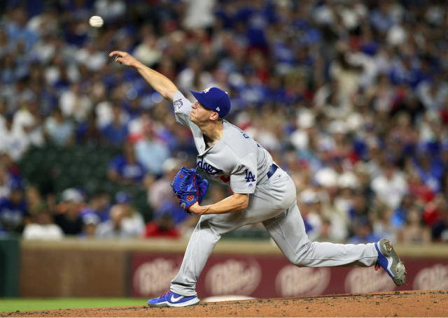 Los Angeles Dodgers starting pitcher Walker Buehler (21) delivers a pitch against the Texas Rangers in the third inning of a baseball game Tuesday, Aug. 28, 2018, in Arlington, Texas. (AP Photo/Richard W. Rodriguez)