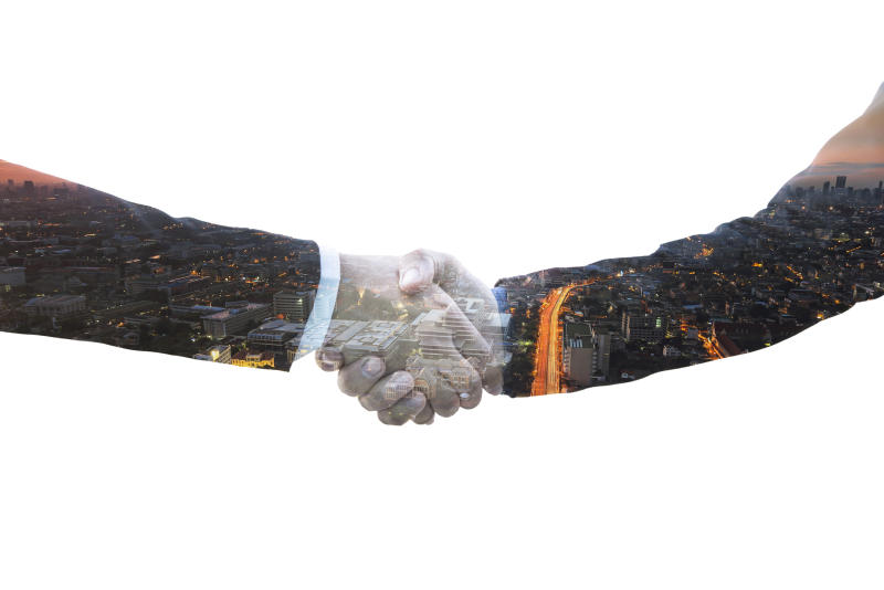 Abstract image of Smart Engineer Foreman Business man shakehand with partnership on city background. Business Logistic and communication successful meeting abstract art double exposure concept.