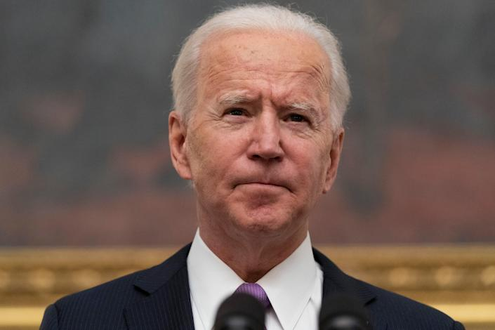<p>President Joe Biden signs executive orders in the Oval Office of the White House in Washington, after his inauguration as the 46th President of the United States. </p> (AP)