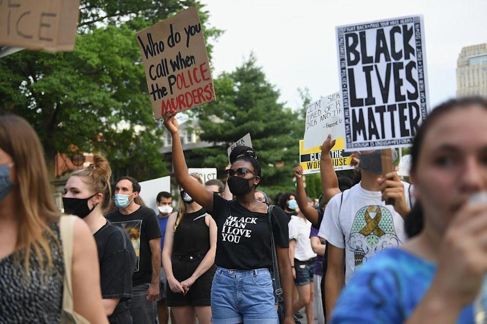 Protesters march against police brutality in St Louis, Missouri, in 2020.