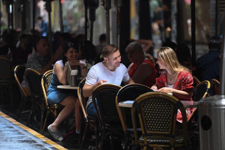 Couple seen dining outside in Melbourne.