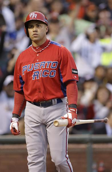 Puerto Rico's Carlos Beltran reacts after striking out against Japan's Kenta Maeda during the third inning of a semifinal game of the World Baseball Classic against Japan in San Francisco, Sunday, March 17, 2013. (AP Photo/Eric Risberg)