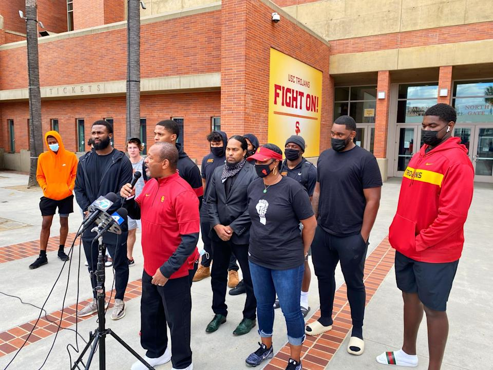 Local civil rights activist Najee Ali speaks at a news conference for suspended USC player Munir McClain