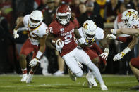 Oklahoma wide receiver CeeDee Lamb (2) carries past Iowa State linebacker Marcel Spears Jr., linebacker O'Rien Vance and defensive back Lawrence White, from left, during the first quarter of an NCAA college football game in Norman, Okla., Saturday, Nov. 9, 2019. (AP Photo/Sue Ogrocki)