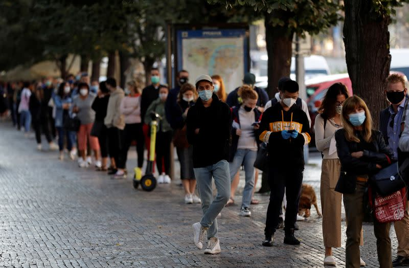 People wait in a line to get tested for the coronavirus disease in Prague