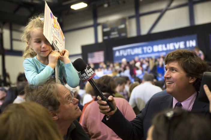 """<p>Lulu Towne, 5, is not thrilled to speak to Fox News' Tucker Carlson during a Bernie Sanders """"Get Out the Vote"""" Rally at Great Bay Community College in Portsmouth. <i>(Photo: Lucian Perkins/The Washington Post via Getty Images)</i></p>"""