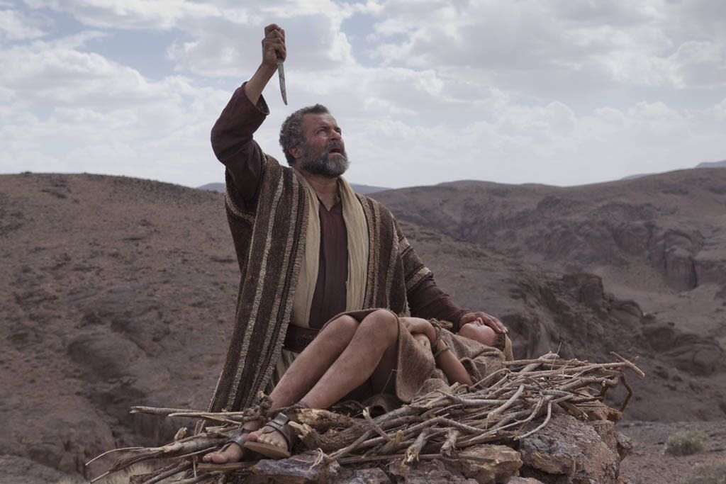 Abraham (GARY OLIVER) prepares Isaac (HUGO ROSSI) for the sacrifice at Mt. Moriah.