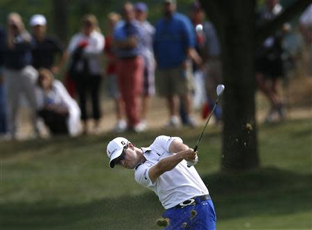 Zach Johnson of U.S. hits from the ninth fairway during the third round of the BMW Championship golf tournament at the Conway Farms Golf Club in Lake Forest, Illinois, September 14, 2013. REUTERS/Jim Young