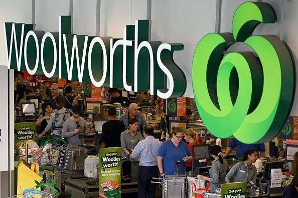 People shop at a Woolworths supermarket in Sydney.