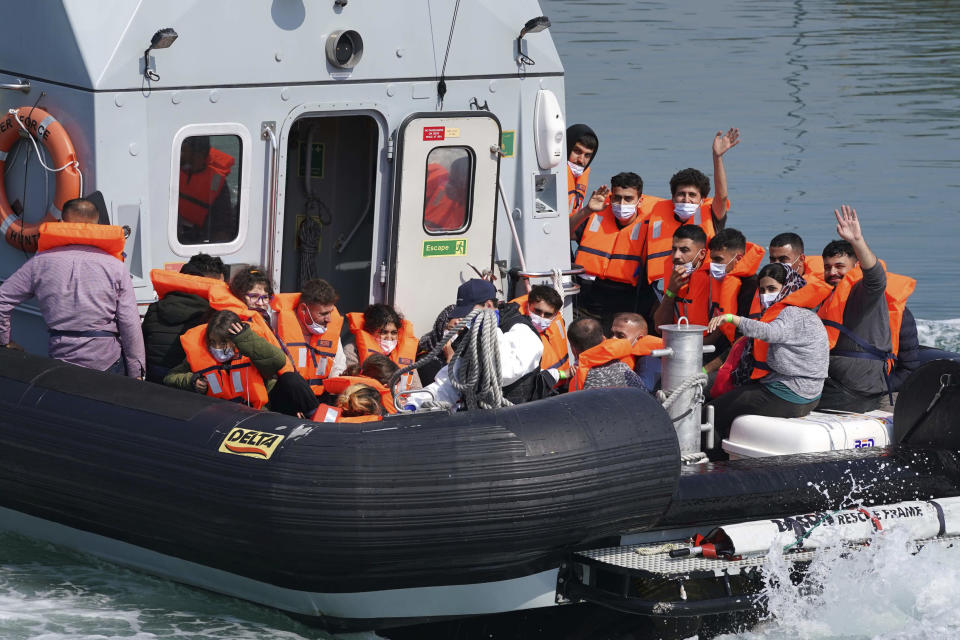 CORRECTING DATE - A group of people thought to be migrants are brought into port aboard a border force boat following a small boat incident in the Channel, at Dover, southern England, Wednesday July 21, 2021. According to information released Tuesday, the number of undocumented migrants reaching Britain in small boats this year has surpassed the total for all of 2020, as people smugglers take advantage of good weather to cross the English Channel from France. (Gareth Fuller/PA via AP)