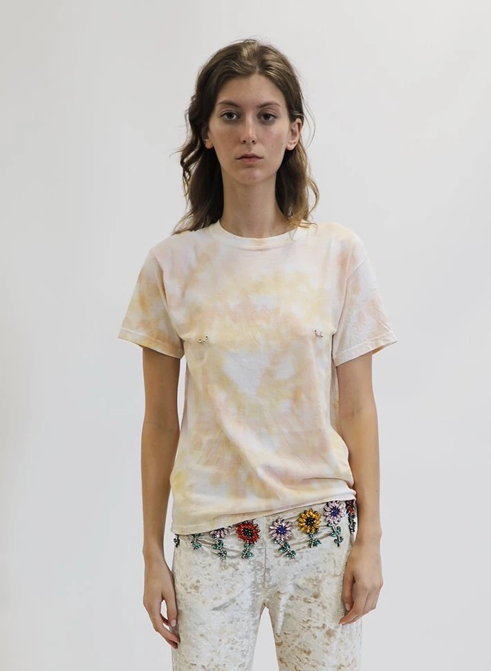"""Why yes, this tie-dye T-shirt <em>does</em> have nipple rings. <br> <br> <strong>Collina Strada</strong> Beige Tie Dye Pierced Tee, $, available at <a href=""""https://go.skimresources.com/?id=30283X879131&url=https%3A%2F%2Fcollinastrada.com%2Fcollections%2Fsale%2Fproducts%2Fbeige-tie-dye-pierced-tee"""" rel=""""nofollow noopener"""" target=""""_blank"""" data-ylk=""""slk:Collina Strada"""" class=""""link rapid-noclick-resp"""">Collina Strada</a>"""