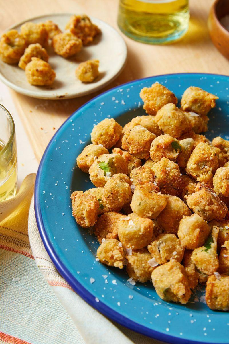 """<p>Fried okra is the best way to enjoy the <a href=""""https://www.delish.com/uk/cooking/recipes/g33323657/grilled-vegetables/"""" rel=""""nofollow noopener"""" target=""""_blank"""" data-ylk=""""slk:vegetable"""" class=""""link rapid-noclick-resp"""">vegetable</a>. Dredging in buttermilk and cornmeal, then frying in a small amount of oil achieves that extra crispy and golden crust. </p><p>Get the <a href=""""https://www.delish.com/uk/cooking/recipes/a33922258/fried-okra-recipe/"""" rel=""""nofollow noopener"""" target=""""_blank"""" data-ylk=""""slk:Fried Okra"""" class=""""link rapid-noclick-resp"""">Fried Okra</a> recipe.</p>"""