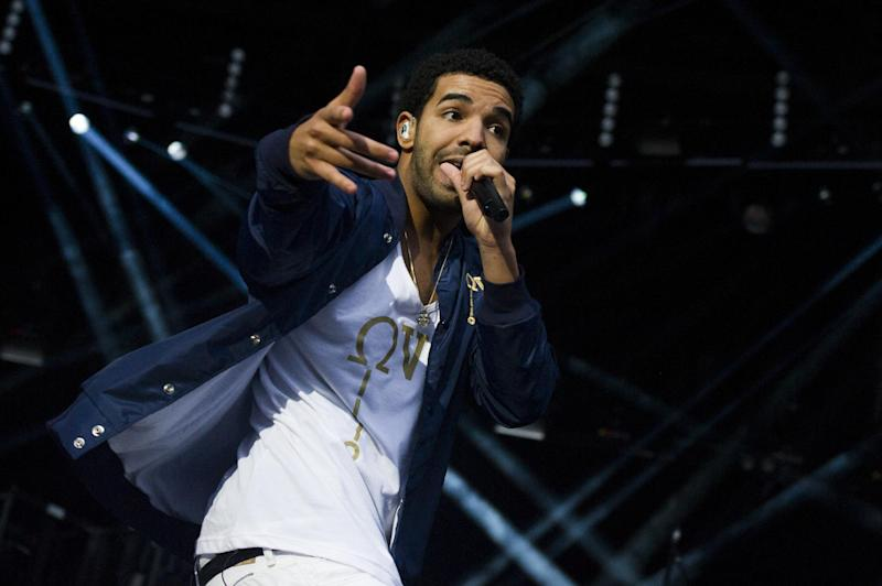 "FILE - This Sept. 2, 2012 file photo shows Drake performing at the ""Made In America"" music festival in Philadelphia. Rihanna and Drake are each nominated for five MTV Video Music Awards being held in Los Angeles at the Staples Center on Thursday, Sept. 6. (Photo by Charles Sykes/Invision/AP, file)"