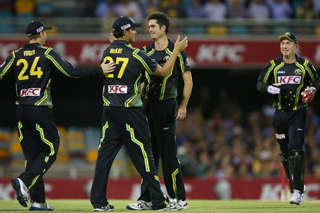 BRISBANE, AUSTRALIA - FEBRUARY 13:  Ben Cutting of Australia celebrates with team mates after Darren Bravo of West Indies is run out during the International Twenty20 match between Australia and the West Indies at The Gabba on February 13, 2013 in Brisbane, Australia.  (Photo by Chris Hyde/Getty Images)