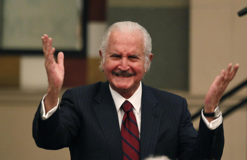FILE - Mexican writer Carlos Fuentes greets the audience during a conference of Peru's Nobel Literature Prize laureate Mario Vargas Llosa in Mexico City, Thursday, March 3, 2011.In this Thursday, March 3, 2011.file photo, Mexican author Carlos Fuentes greets the audience during a conference of Peru's Nobel Literature Prize laureate Mario Vargas Llosa in Mexico City. Fuentes, Mexico's most celebrated novelist and among Latin America's most prominent authors, died on May 15, 2012. (AP Photo/Eduardo Verdugo, File)