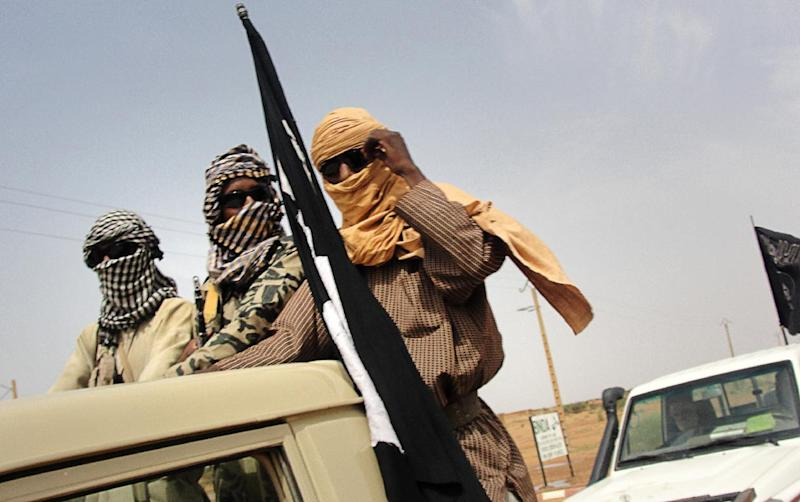 Members of Islamic group of Movement for Oneness and Jihad in West Africa (MUJAO) stand guard near the Gao, Mali on August 7, 2012