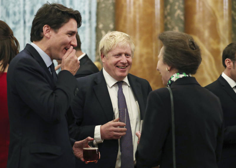 Britain's Princess Anne The Princess Royal, right, talks to NATO delegates from left, Canadian Prime Minister Justin Trudeau and Britain's Prime Minister Boris Johnson, during a reception at Buckingham Palace, in London, as Nato leaders attend to mark 70 years of the alliance, Tuesday Dec. 3, 2019.  While NATO leaders are publicly professing unity as they gather for the London summit, several seem to have been caught in an unguarded exchange on camera apparently gossiping about U.S. President Donald Trump's behaviour. In footage recorded during the Buckingham Palace reception on Tuesday, Canadian Prime Minister Justin Trudeau was seen standing in a huddle with French President Emmanuel Macron, British Prime Minister Boris Johnson, Dutch Prime Minister Mark Rutte and Britain's Princess Anne. (Yui Mok/Pool via AP)