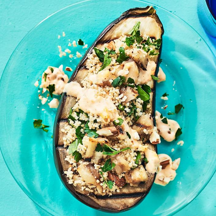 <p>Smoky almonds, meaty eggplant and whole-grain couscous with herbs make this meal plenty satisfying. Harissa gives the creamy sauce a little kick.</p>