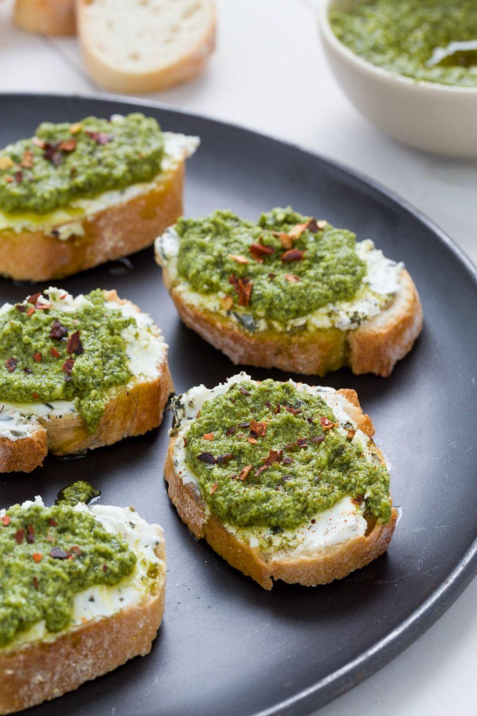 "<p>You might even like pesto better on bread than you do on pasta.</p><p>Get the recipe from <a href=""https://www.delish.com/holiday-recipes/new-years/g1562/crostini/?slide=10"" rel=""nofollow noopener"" target=""_blank"" data-ylk=""slk:Delish"" class=""link rapid-noclick-resp"">Delish</a>.</p>"
